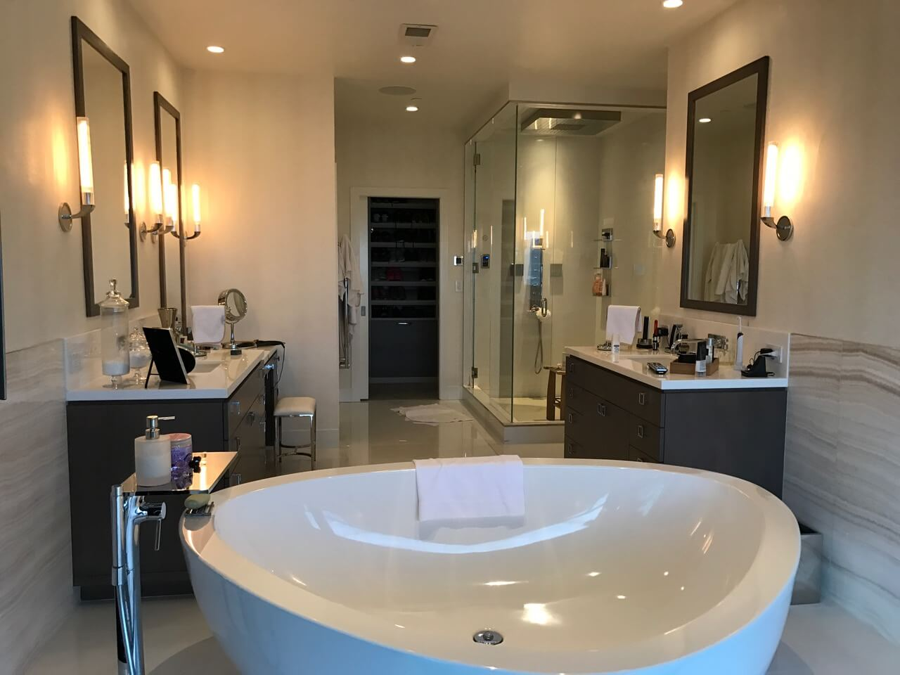 Deluxe bathroom with free standing bathtub and multiple fixtures shower