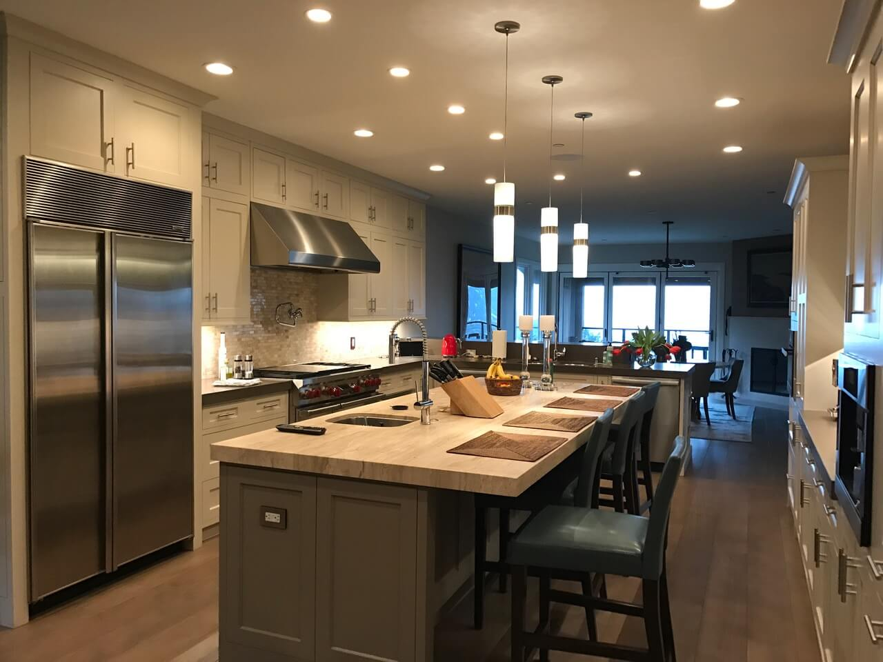 Contemporary kitchen with nana doors to deck