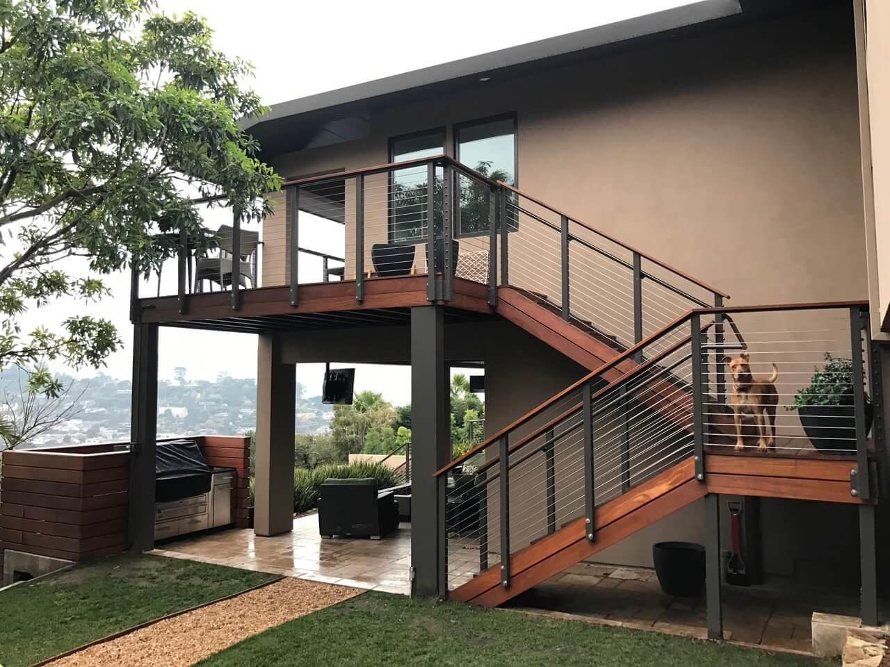 Sustainably harvested tropical wood deck and stairs with cable railing